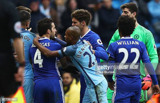 Cesc Fabregas of Chelsea and Fernandinho of Manchester City clash during the Premier League match between Manchester City and Chelsea at Etihad...