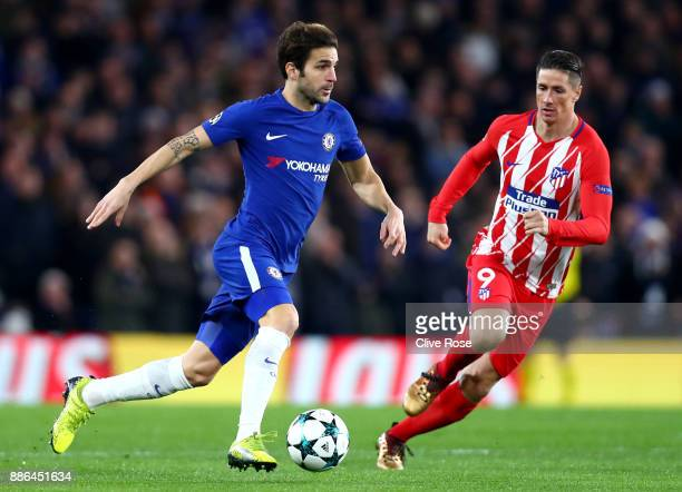 Cesc Fabregas of Chelsea and Fernando Torres of Atletico Madrid in action during the UEFA Champions League group C match between Chelsea FC and...
