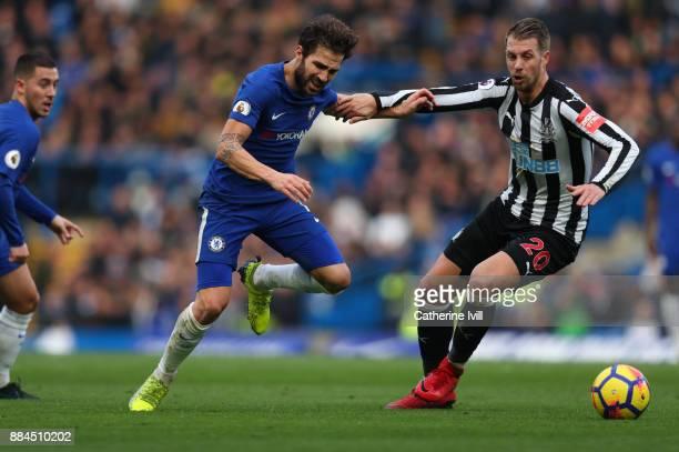 Cesc Fabregas of Chelsea and Florian Lejeune of Newcastle United during the Premier League match between Chelsea and Newcastle United at Stamford...