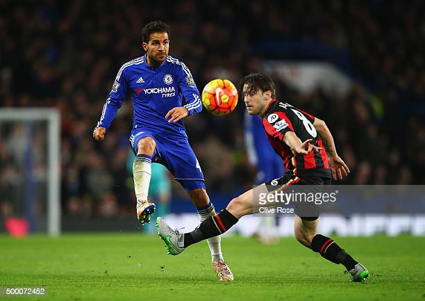 Cesc Fabregas of Chelsea and Harry Arter of Bournemouth compete for the ball during the Barclays Premier League match between Chelsea and AFC...