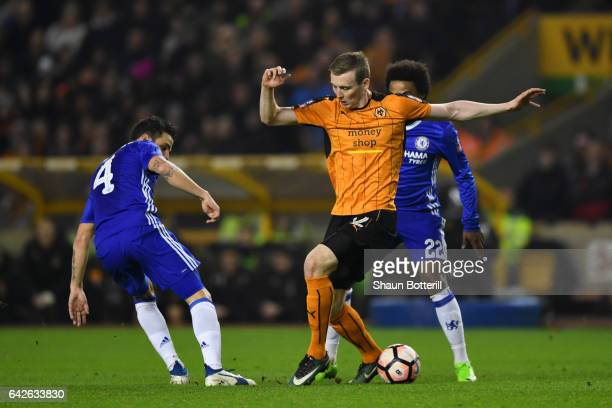 Cesc Fabregas of Chelsea and Jon Dadi Bodvarsson of Wolves battle for possession during The Emirates FA Cup Fifth Round match between Wolverhampton...