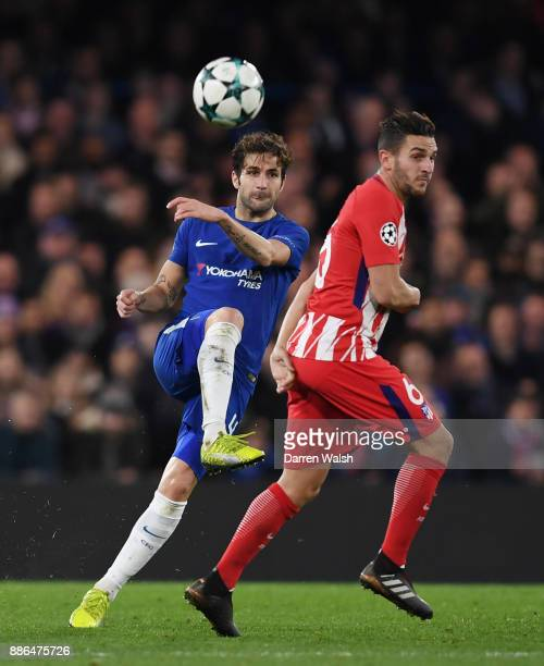 Cesc Fabregas of Chelsea and Koke of Atletico Madrid during the UEFA Champions League group C match between Chelsea FC and Atletico Madrid at...