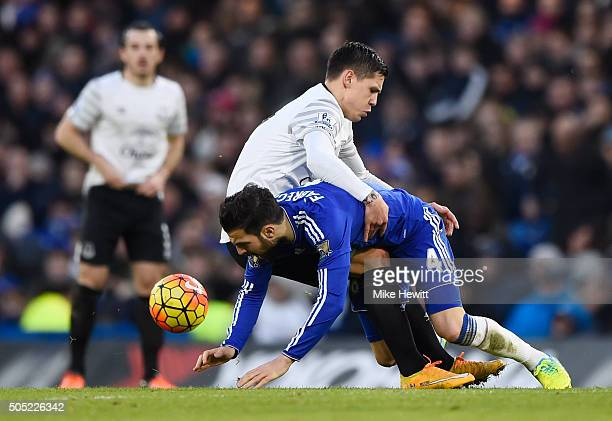 Cesc Fabregas of Chelsea and Muhamed Besic of Everton compete for the ball during the Barclays Premier League match between Chelsea and Everton at...