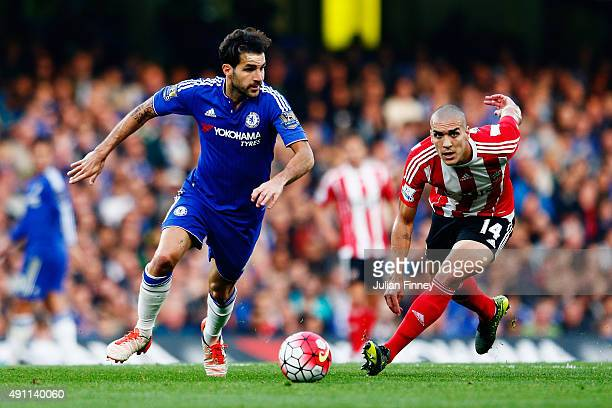 Cesc Fabregas of Chelsea and Oriol Romeu of Southampton compete for the ball during the Barclays Premier League match between Chelsea and Southampton...