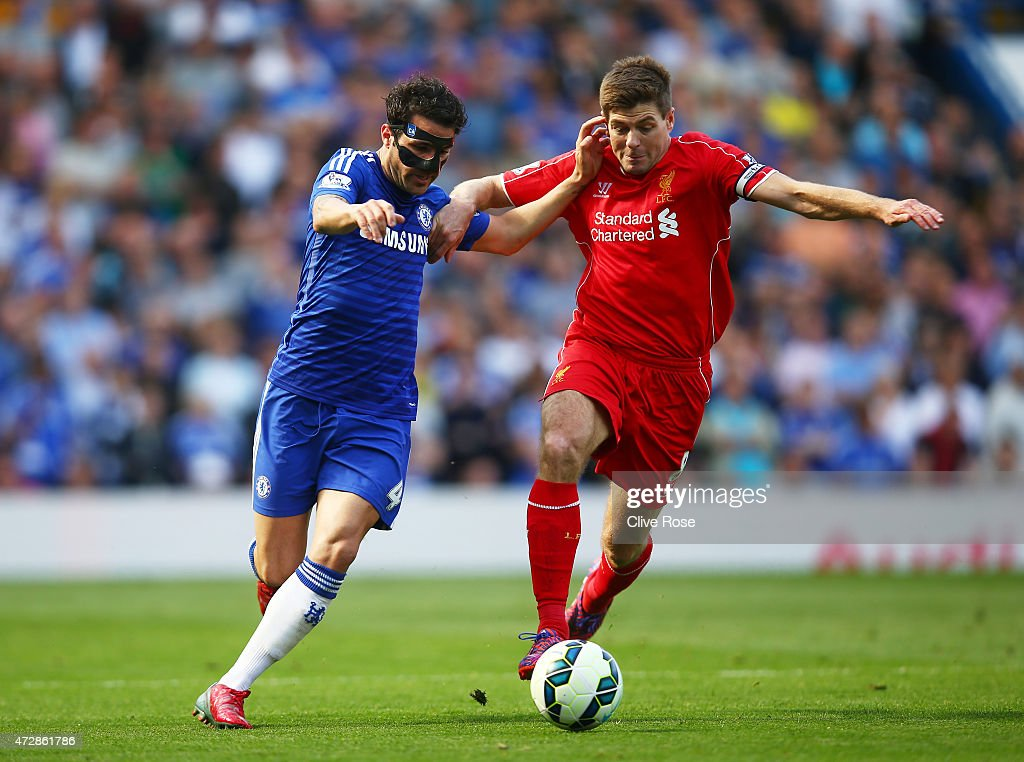 Cesc Fabregas of Chelsea and Steven Gerrard of Liverpool compete for the ball during the Barclays Premier League match between Chelsea and Liverpool at Stamford Bridge on May 10, 2015 in London, England.
