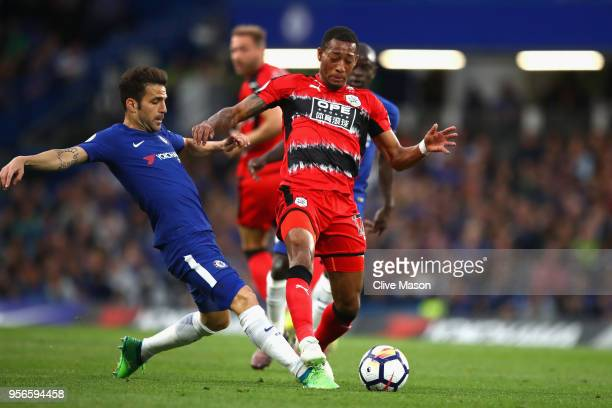 Cesc Fabregas of Chelsea battles for possession with Rajiv van La Parra of Huddersfield Town during the Premier League match between Chelsea and...
