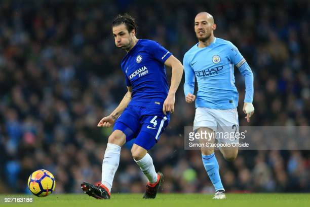 Cesc Fabregas of Chelsea battles with David Silva of Man City during the Premier League match between Manchester City and Chelsea at the Etihad...