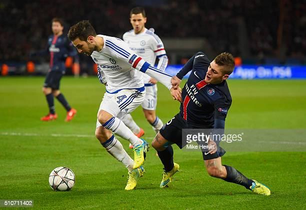 Cesc Fabregas of Chelsea battles with Marco Verratti of Paris SaintGermain during the UEFA Champions League round of 16 first leg match between Paris...