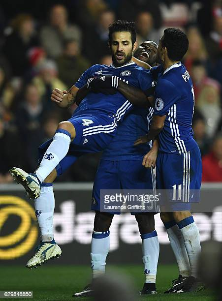 Cesc Fabregas of Chelsea celebrates scoring his sides first goal with his Chelsea team mates Victor Moses and Pedro during the Premier League match...