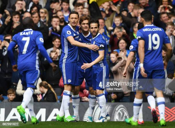 Cesc Fabregas of Chelsea celebrates scoring his sides first goal with his Chelsea team mates during the Premier League match between Chelsea and...