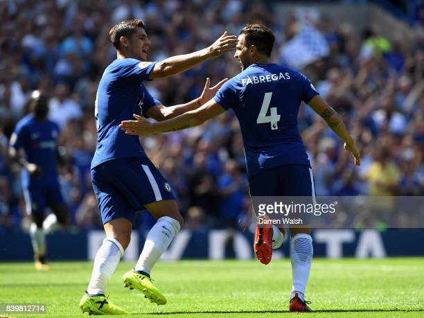 Cesc Fabregas of Chelsea celebrates scoring his sides first goal with Alvaro Morata of Chelsea during the Premier League match between Chelsea and...