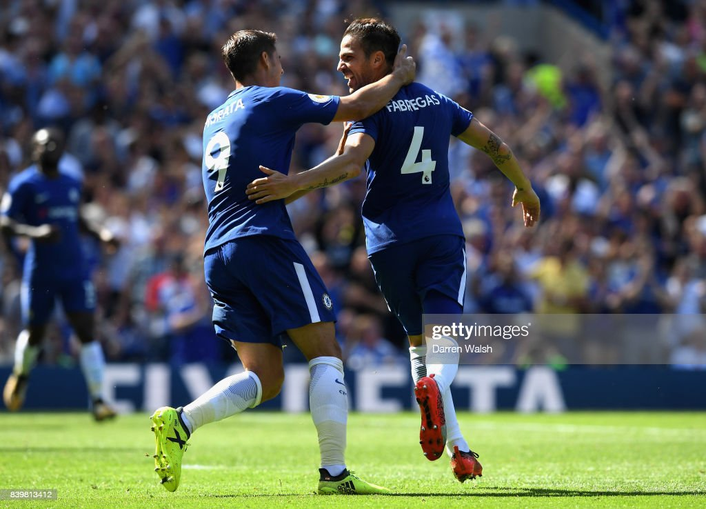 Cesc Fabregas of Chelsea celebrates scoring his sides first goal with Alvaro Morata of Chelsea during the Premier League match between Chelsea and Everton at Stamford Bridge on August 27, 2017 in London, England.