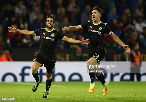 Cesc Fabregas of Chelsea celebrates scoring his sides fourth goal with Gary Cahill of Chelsea during the EFL Cup Third Round match between Leicester...