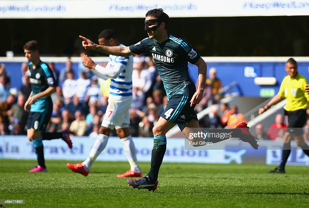 Cesc Fabregas of Chelsea celebrates scoring the opening goal during the Barclays Premier League match between Queens Park Rangers and Chelsea at Loftus Road on April 12, 2015 in London, England.