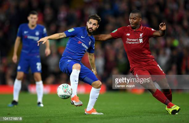 Cesc Fabregas of Chelsea controls the ball as Daniel Sturridge of Liverpool looks on during the Carabao Cup Third Round match between Liverpool and...