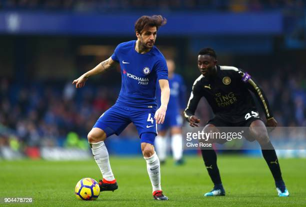 Cesc Fabregas of Chelsea controls the ball under pressure from Wilfred Ndidi of Leicester City during the Premier League match between Chelsea and...