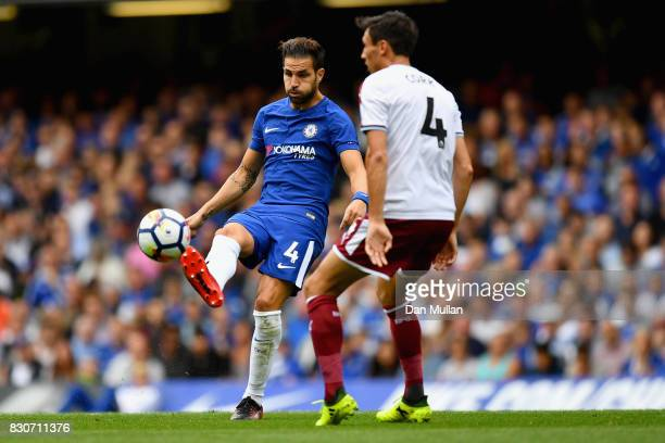 Cesc Fabregas of Chelsea controls the ball while under pressure from Jack Cork of Burnley during the Premier League match between Chelsea and Burnley...