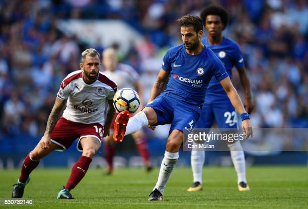 Cesc Fabregas of Chelsea controls the ball while under pressure from Steven Defour of Burnley during the Premier League match between Chelsea and...