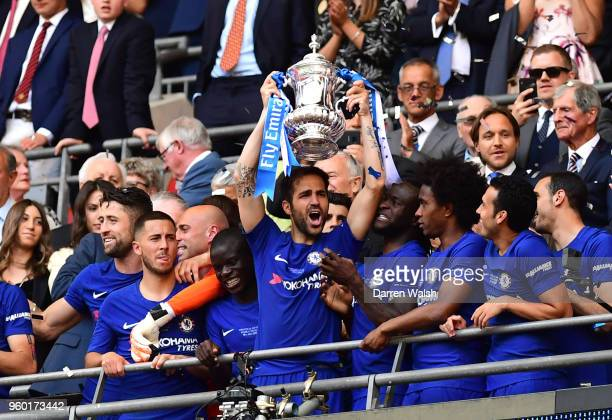 Cesc Fabregas of Chelsea holds the Emirates FA Cup trophy in celebration of his side's win following The Emirates FA Cup Final between Chelsea and...
