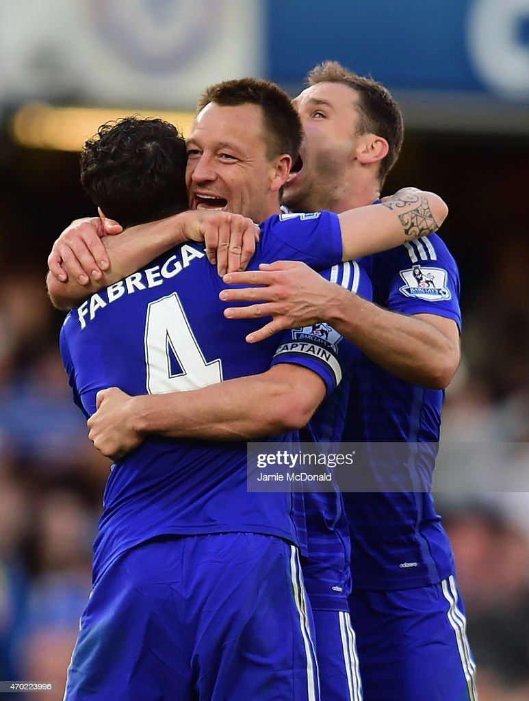 Cesc Fabregas of Chelsea hugs John Terry and Branislav Ivanovic of Chelsea after the Barclays Premier League match between Chelsea and Manchester United at Stamford Bridge on April 18, 2015 in London, England.