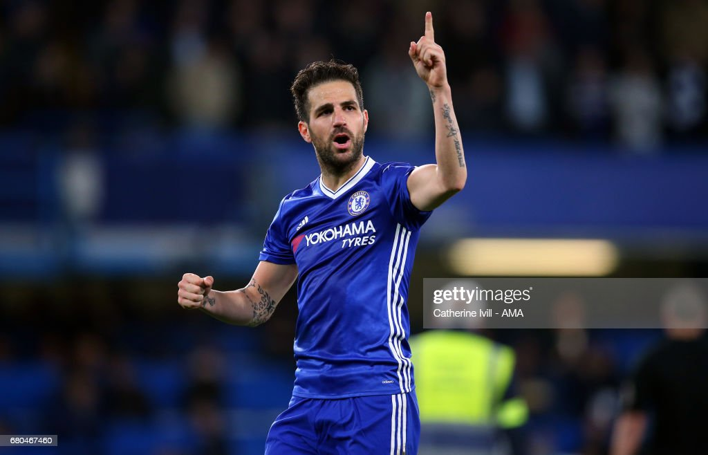 Cesc Fabregas of Chelsea indicates to the fans they need to win one more game after the Premier League match between Chelsea and Middlesbrough at Stamford Bridge on May 8, 2017 in London, England.