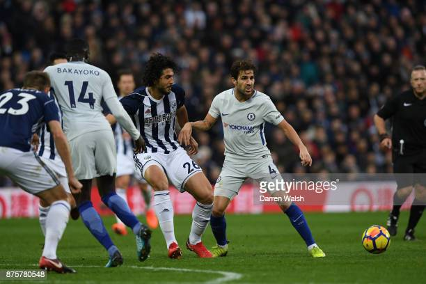 Cesc Fabregas of Chelsea is challenged by Ahmed ElSayed Hegazi of West Bromwich Albion during the Premier League match between West Bromwich Albion...