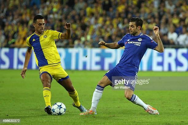 Cesc Fabregas of Chelsea is challenged by Eran Zahavi of Maccabi TelAviv during the UEFA Champions League Group G match between Maccabi TelAviv FC...