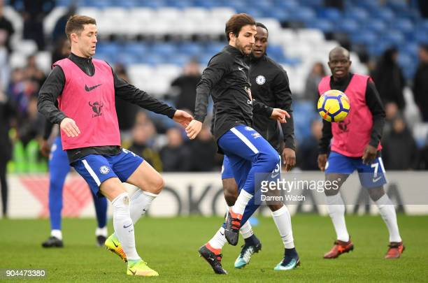 Cesc Fabregas of Chelsea is challenged by Gary Cahill of Chelsea as they warm up prior to the Premier League match between Chelsea and Leicester City...