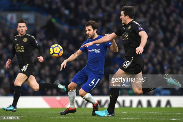 Cesc Fabregas of Chelsea is challenged by Harry Maguire of Leicester City during the Premier League match between Chelsea and Leicester City at...