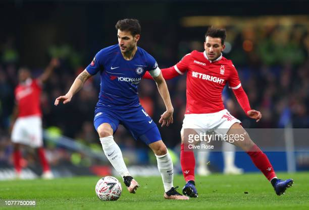 Cesc Fabregas of Chelsea is challenged by Matty Cash of Nottingham Forest during the FA Cup Third Round match between Chelsea and Nottingham Forest...