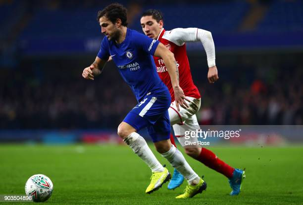 Cesc Fabregas of Chelsea is closed down by Hector Bellerin of Arsenal during the Carabao Cup SemiFinal First Leg match between Chelsea and Arsenal at...