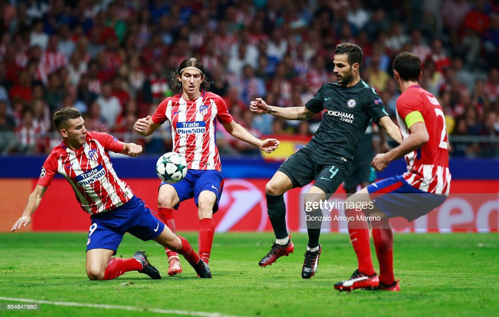 Cesc Fabregas of Chelsea is surrounded Atletico Madrid defenders during the UEFA Champions League group C match between Atletico Madrid and Chelsea FC at Estadio Wanda Metropolitano on September 27, 2017 in Madrid, Spain.