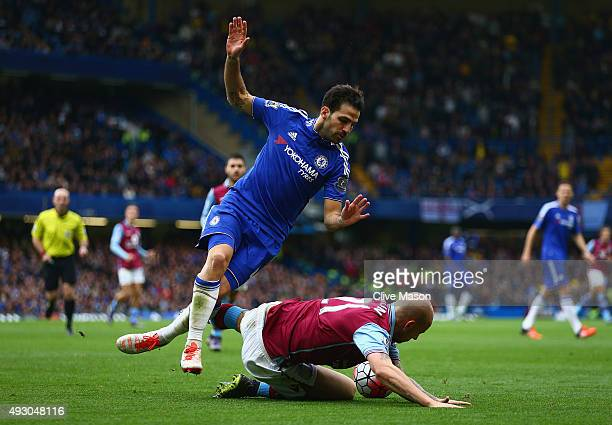 Cesc Fabregas of Chelsea is tackled by Alan Hutton of Aston Villa during the Barclays Premier League match between Chelsea and Aston Villa at...