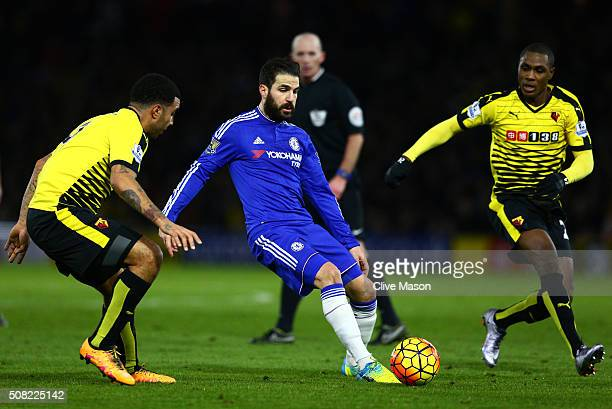 Cesc Fabregas of Chelsea passes as Troy Deeney of Watford and Odion Ighalo of Watford close in during the Barclays Premier League match between...