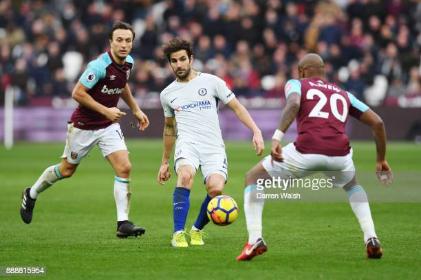 Cesc Fabregas of Chelsea passes teh ball during the Premier League match between West Ham United and Chelsea at London Stadium on December 9 2017 in...