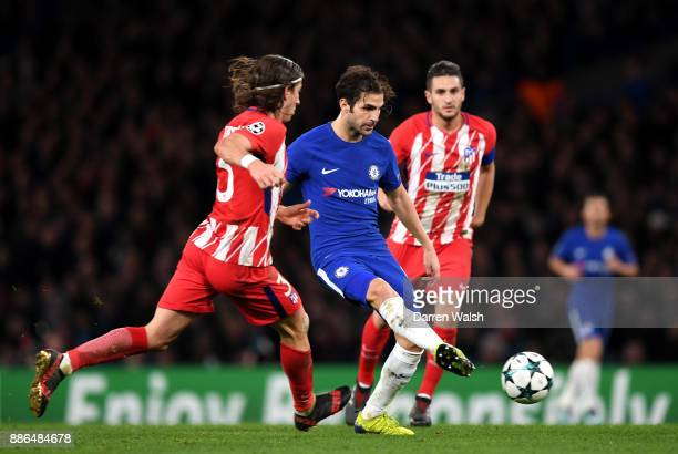 Cesc Fabregas of Chelsea passes the ball while under pressure from Filipe Luis of Atletico Madrid during the UEFA Champions League group C match...
