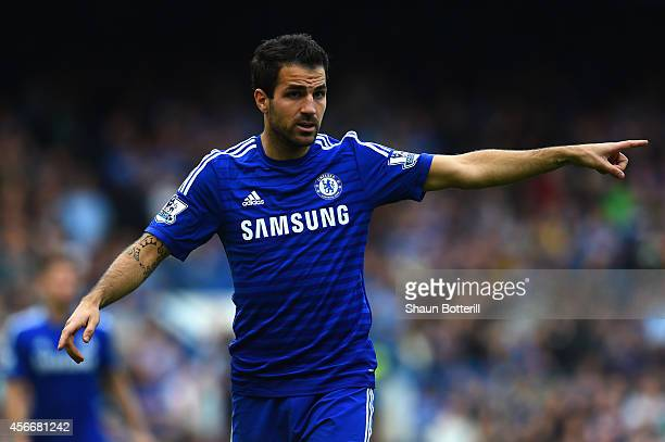 Cesc Fabregas of Chelsea points during the Barclays Premier League match between Chelsea and Arsenal at Stamford Bridge on October 4 2014 in London...