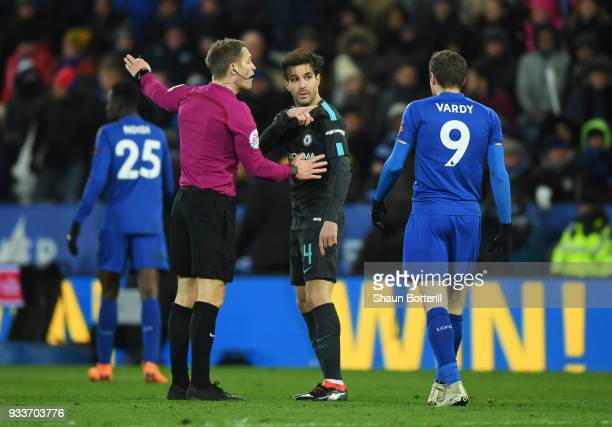 Cesc Fabregas of Chelsea points towards Jamie Vardy of Leicester City as referee Craig Pawson intervenes during The Emirates FA Cup Quarter Final...