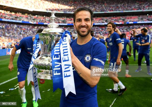 Cesc Fabregas of Chelsea poses with the Emirates FA Cup trophy following his sides victory in The Emirates FA Cup Final between Chelsea and...