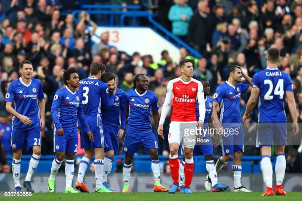 Cesc Fabregas of Chelsea reacts after scoring his team's third goal during the Premier League match between Chelsea and Arsenal at Stamford Bridge on...