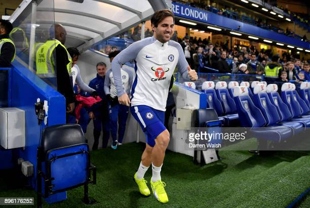 Cesc Fabregas of Chelsea runs onto the pitch for the warm up prior to the Carabao Cup QuarterFinal match between Chelsea and AFC Bournemouth at...
