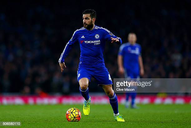 Cesc Fabregas of Chelsea runs with the ball during the Barclays Premier League match between Arsenal and Chelsea at Emirates Stadium on January 24...