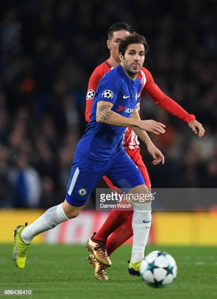Cesc Fabregas of Chelsea runs with the ball during the UEFA Champions League group C match between Chelsea FC and Atletico Madrid at Stamford Bridge...
