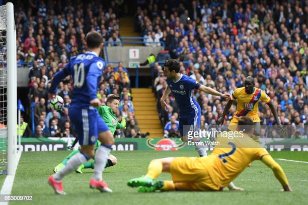 Cesc Fabregas of Chelsea scores his sides first goal during the Premier League match between Chelsea and Crystal Palace at Stamford Bridge on April 1...