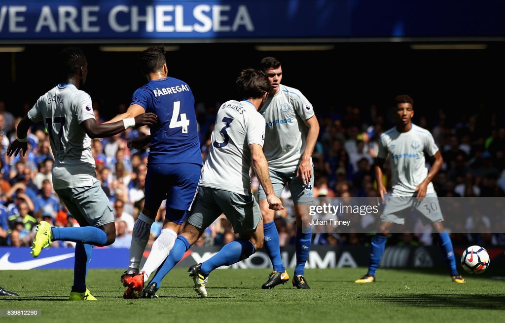 Cesc Fabregas of Chelsea scores his sides first goal during the Premier League match between Chelsea and Everton at Stamford Bridge on August 27, 2017 in London, England.