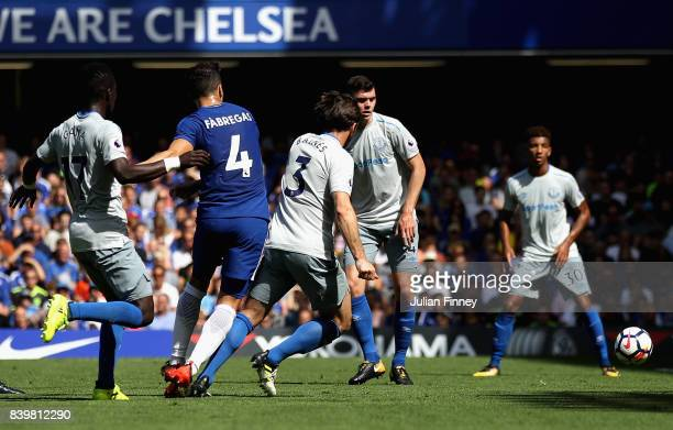 Cesc Fabregas of Chelsea scores his sides first goal during the Premier League match between Chelsea and Everton at Stamford Bridge on August 27 2017...
