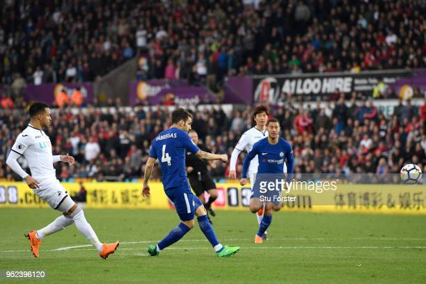 Cesc Fabregas of Chelsea scores his sides first goal during the Premier League match between Swansea City and Chelsea at Liberty Stadium on April 28...