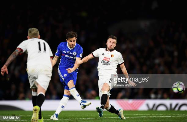 Cesc Fabregas of Chelsea scores his sides fourth goal as Tom Cleverley of Watford attempts to block during the Premier League match between Chelsea...