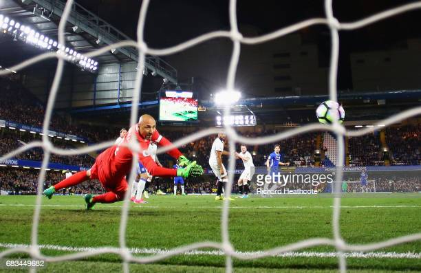 Cesc Fabregas of Chelsea scores his sides fourth goal past Heurelho Gomes of Watford during the Premier League match between Chelsea and Watford at...