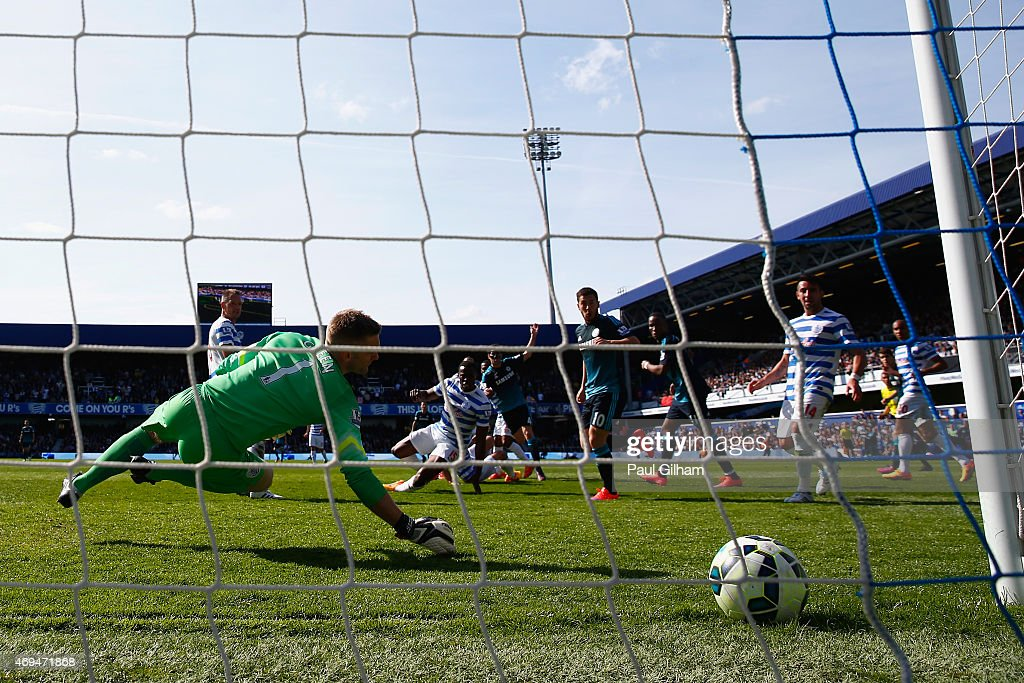 Cesc Fabregas of Chelsea scores the first goal past Robert Green of QPR during the Barclays Premier League match between Queens Park Rangers and Chelsea at Loftus Road on April 12, 2015 in London, England.